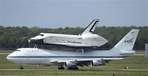 Space shuttle Enterprise lands in New York atop jet