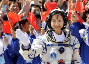 China puts its first woman astronaut into orbit