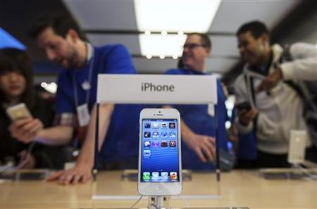Apple shares fall on reports of cuts to iPhone parts orders