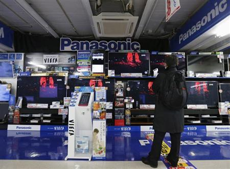 A man looks at Panasonic TV sets at an electronic shop in Tokyo