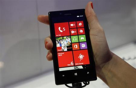 The new Nokia Lumia 720, featuring the same camera lens as the higher end Lumia 920, is pictured during the Mobile World Congress in Barcelona