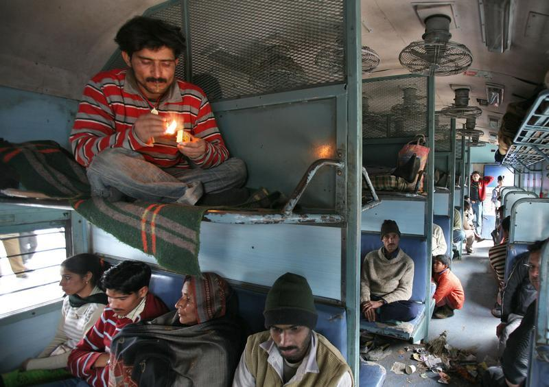A commuter smokes inside a passenger train in Jammu