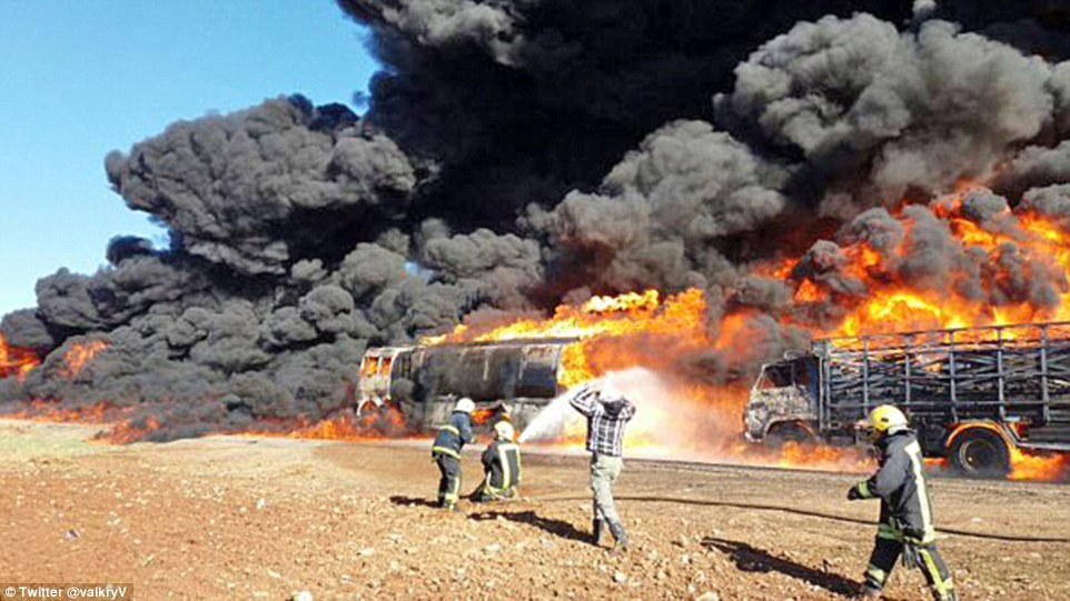 Up in smoke: ISIS oil convoy is obliterated by Russian air strike in Syria days after Putin said Turkey was buying it from Islamists