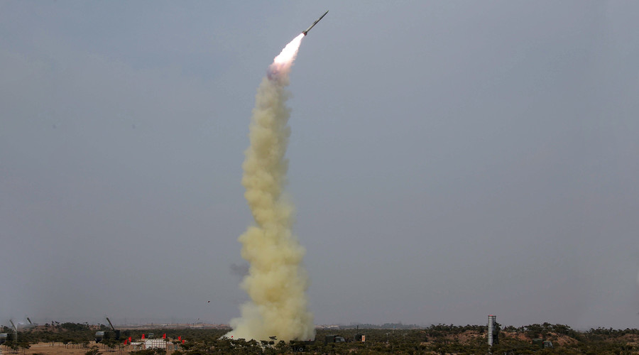 N. Korea tests new missile while Washington nuclear summit on
