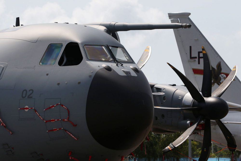An Airbus A400M military aircraft operated by the Royal Malaysian Air Force (RMAF) stands on display at the Singapore Airshow held at the Changi Exhibition Centre in Singapore, on Tuesday, Feb. 16, 2016., on Tuesday, Feb. 16, 2016. The air show runs through Feb. 21. Photographer: SeongJoon Cho/Bloomberg via Getty Images